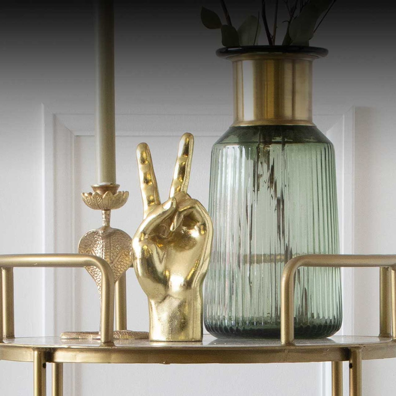 Gold Peace Hand Ornament on gold drinks trolley