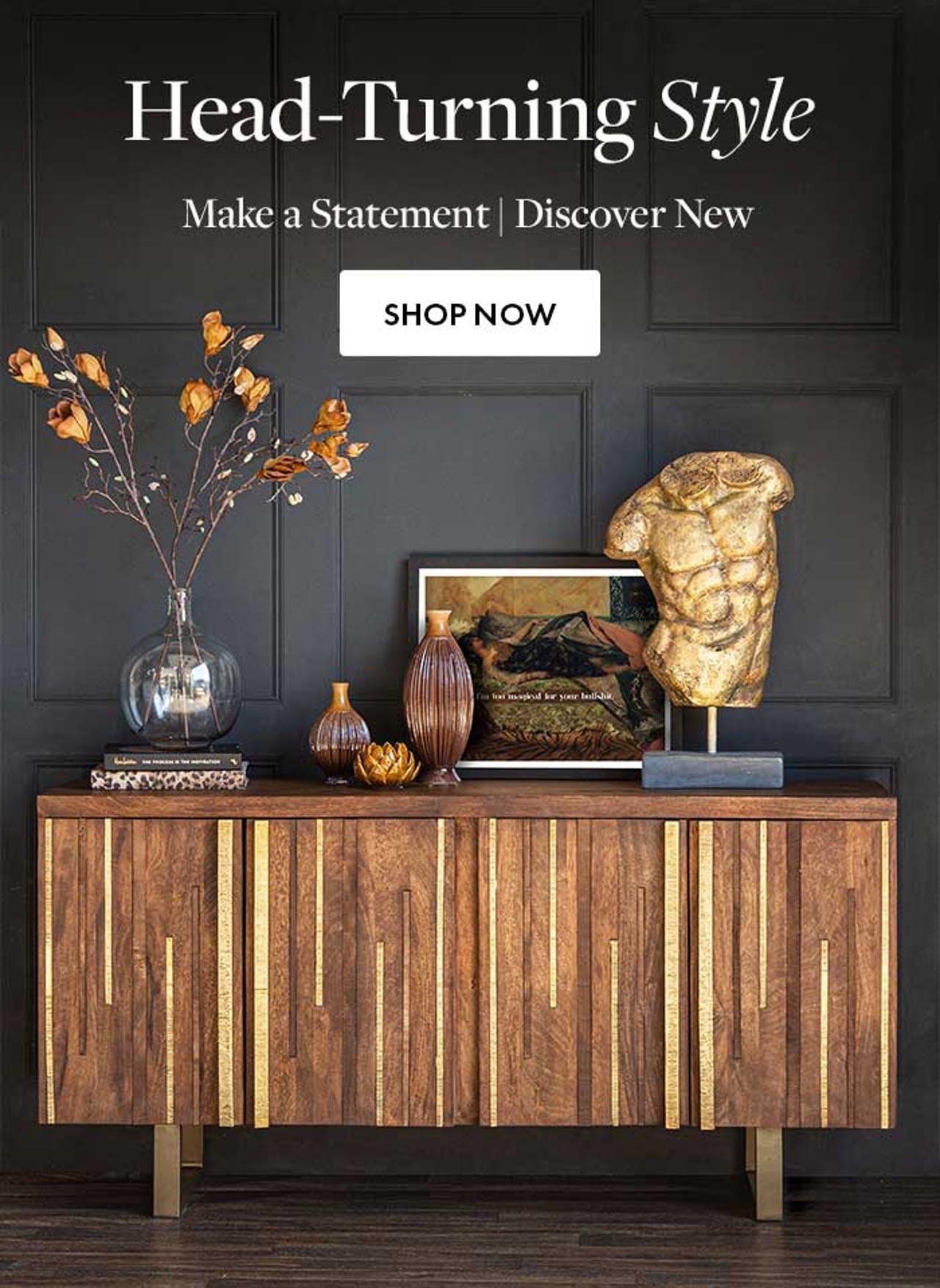 Wood and Brass sideboard cabinet with quirky ornaments and an art print