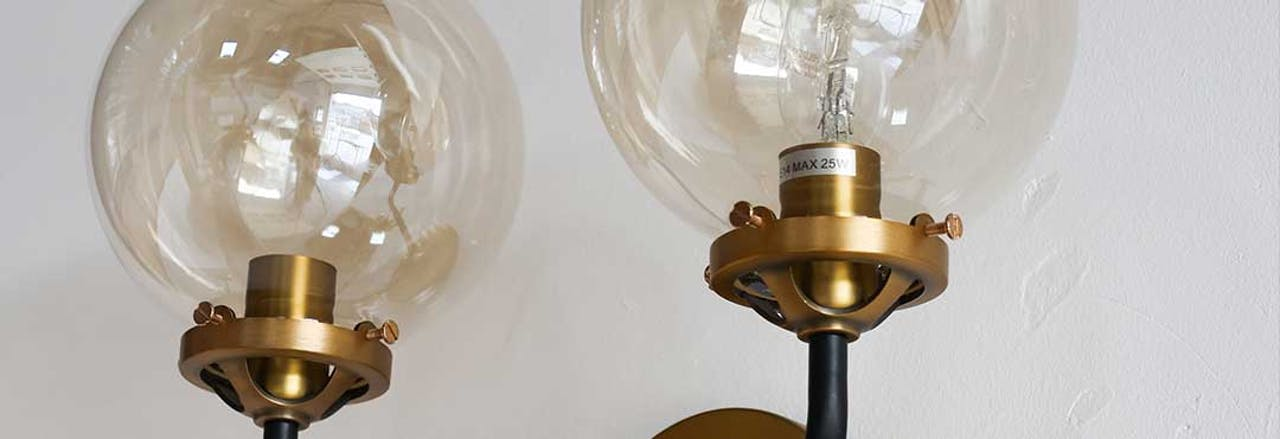 Two sphere bulbs on wall light