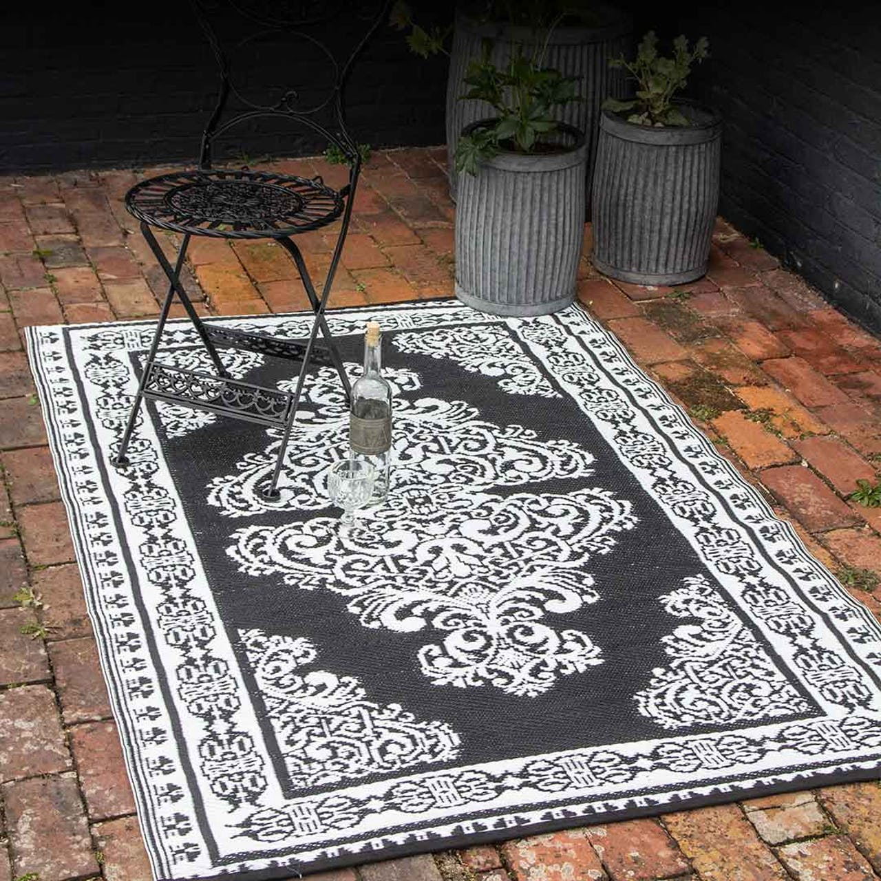 intricate patterned black and white rug outdoors