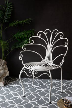 Close-up image of the Pretty White Peacock Garden Chair