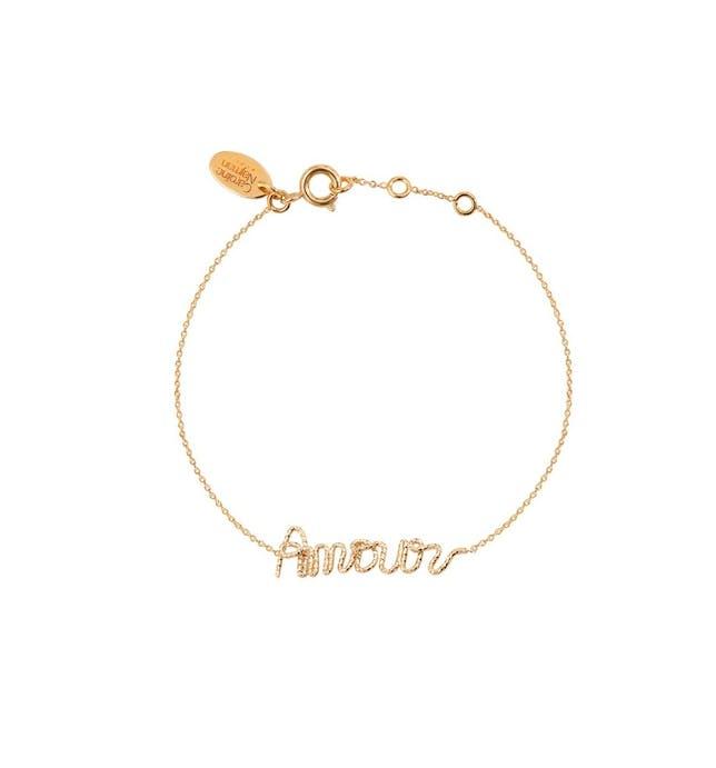 Bracelet avec un mot calligraphié : Amour La longueur de ce bracelet est de : 15 cm