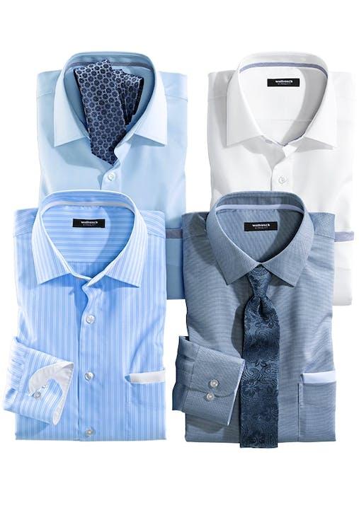Vier Hemden in blau, weiß oder gestreift. Auf zwei Hemden liegt jeweils eine dunkelblaue Krawatte.