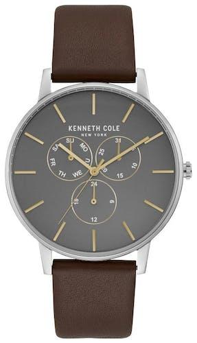 Cette montre KENNETH COLE se compose d'un Boîtier Rond de 42 mm et d'un bracelet en Cuir Marron