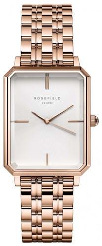 Cette montre ROSEFIELD se compose d'un boîtier Rectangle de 29 mm x 23 mm et d'un bracelet en Acier Rose