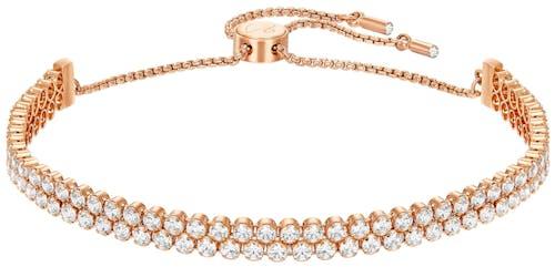 Ce Bracelet SWAROVSKI est en Métal Rose et Cristal