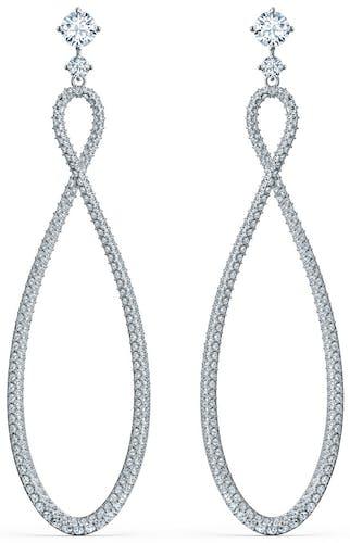 Ces Boucles d'oreilles SWAROVSKI sont en Métal Blanc