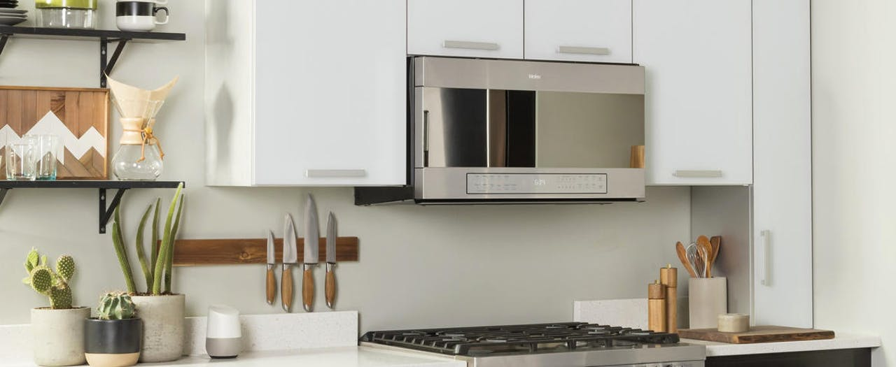 Haier stainless steal microwave installed in a contemporary kitchen