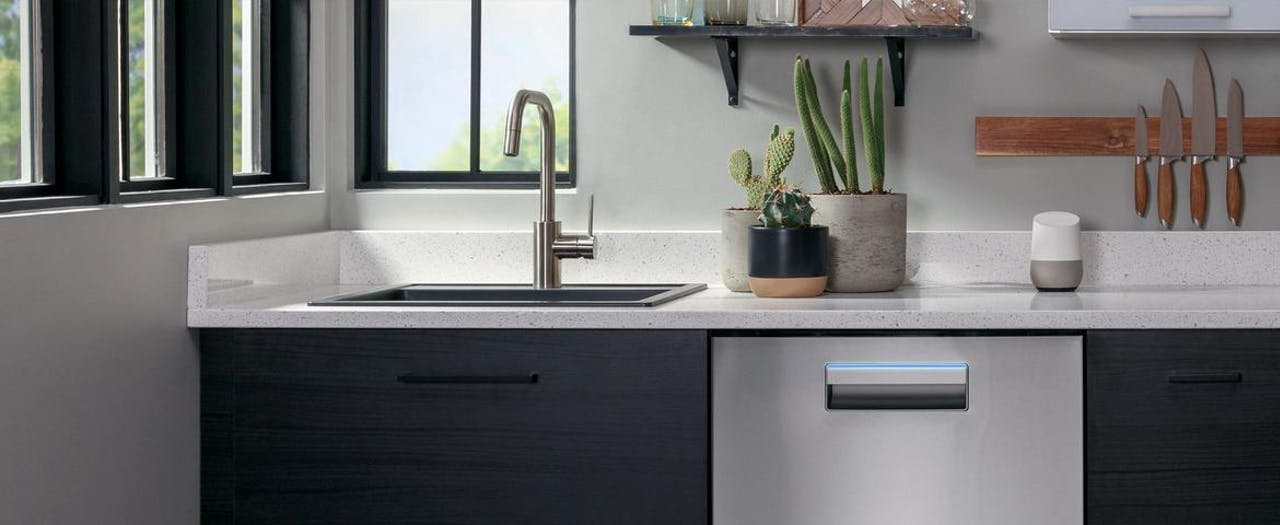 Haier stainless dishwasher installed in contemporary home.
