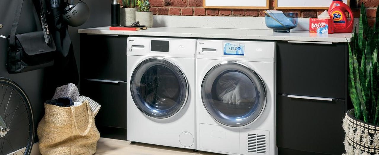 Haier front load washer and ventless dryer installed in urban home.