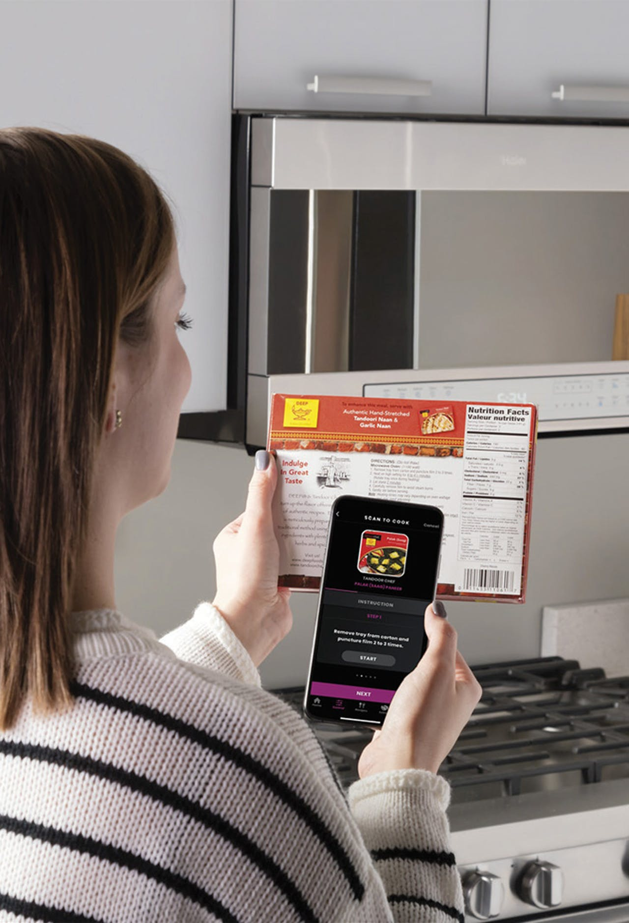 Woman using the scan-to-cook function from the SmartHQ app on her phonne