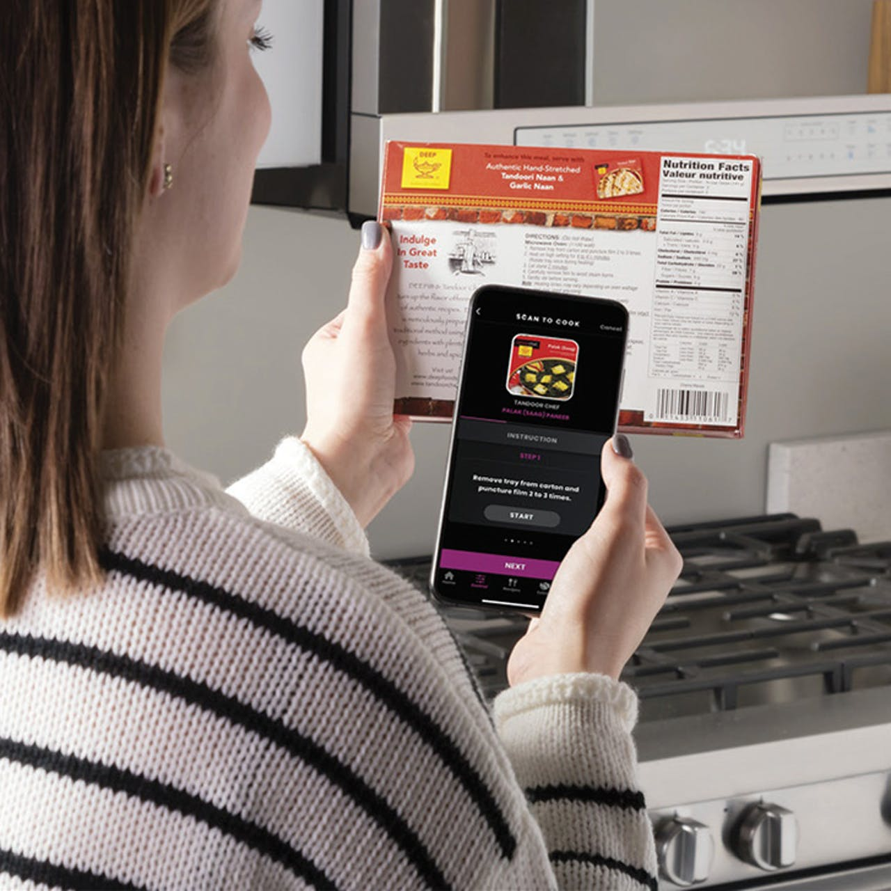 Woman using the scan-to-cook function from the SmartHQ app on her phone
