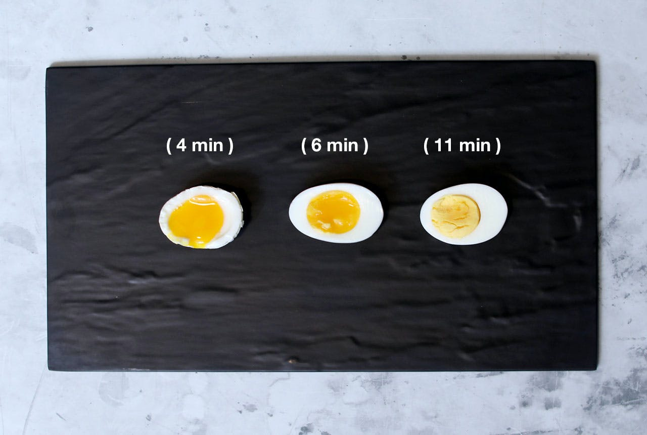 Three eggs shown cooked at different amounts of time.