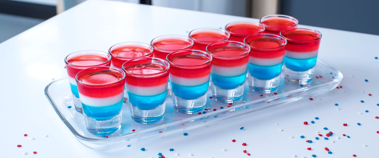 12 red, white and blue jello shots on a platter