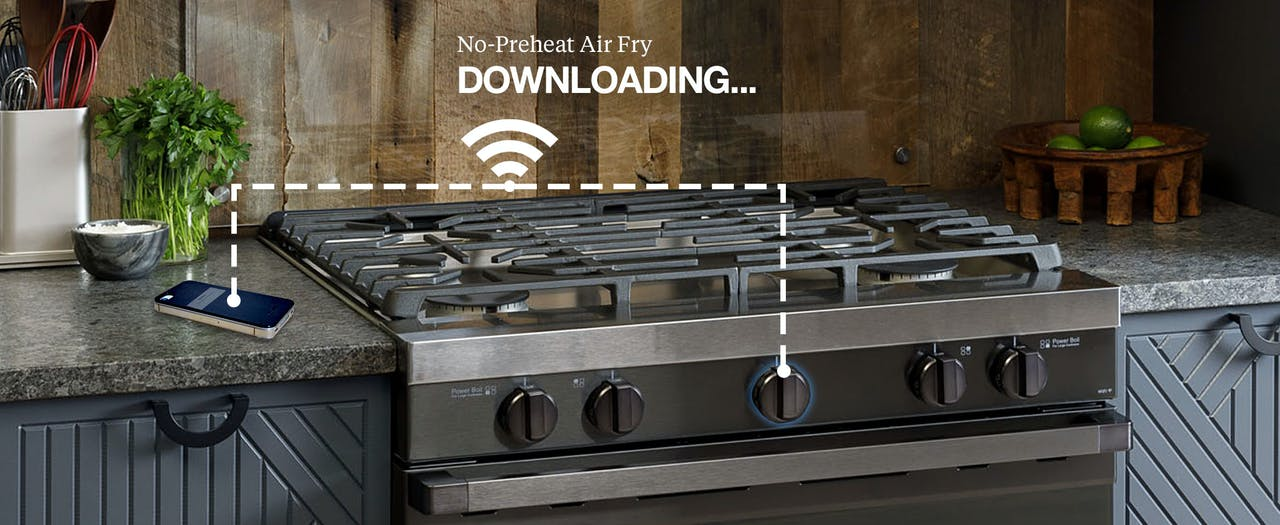 Haier Gas Range communicating via WiFi to a mobile phone on kitchen counter to download the Air Fry Cooking mode..