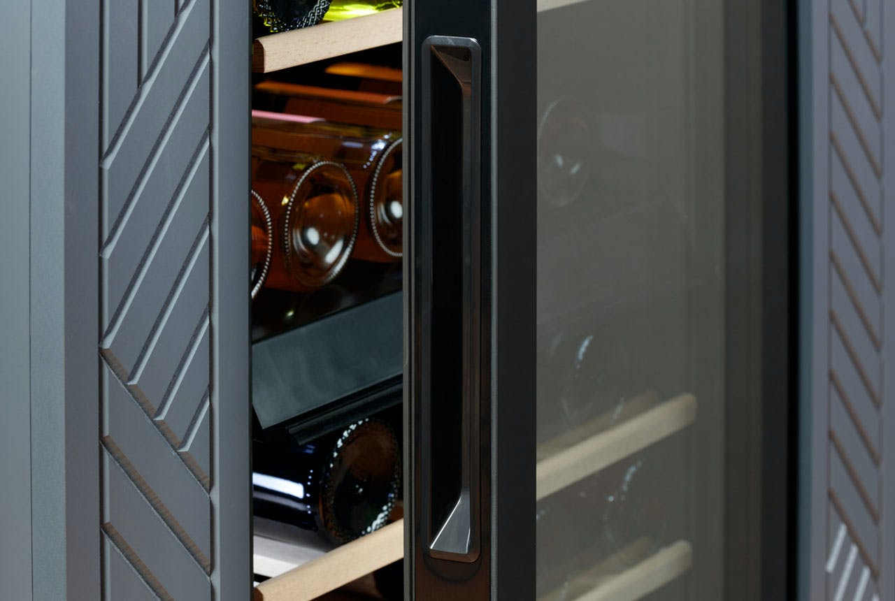 Haier wine center with integrated handles, flush with the glass door.