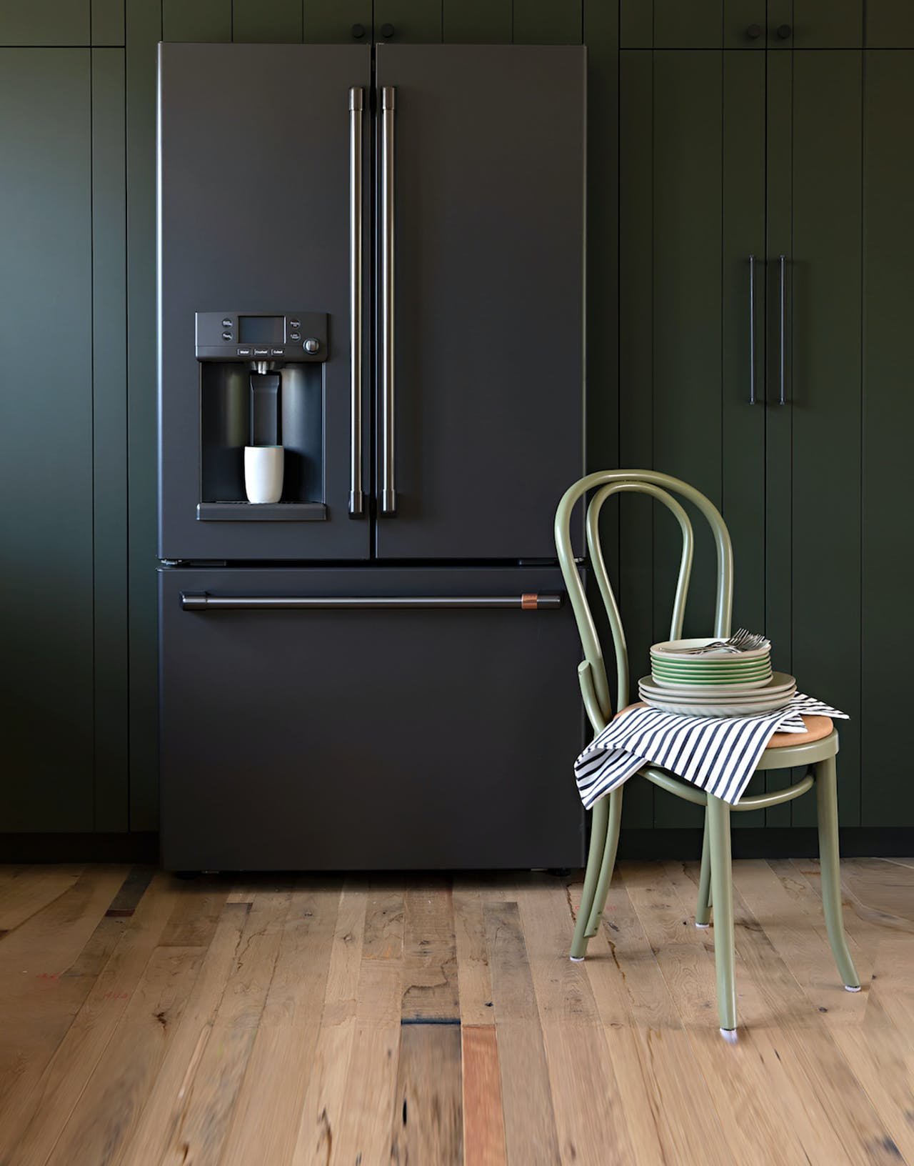matte black French door refrigerator in sage green cabinets