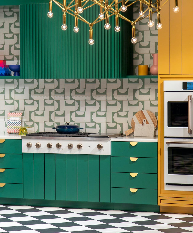 matte white rangetop in green cabinets
