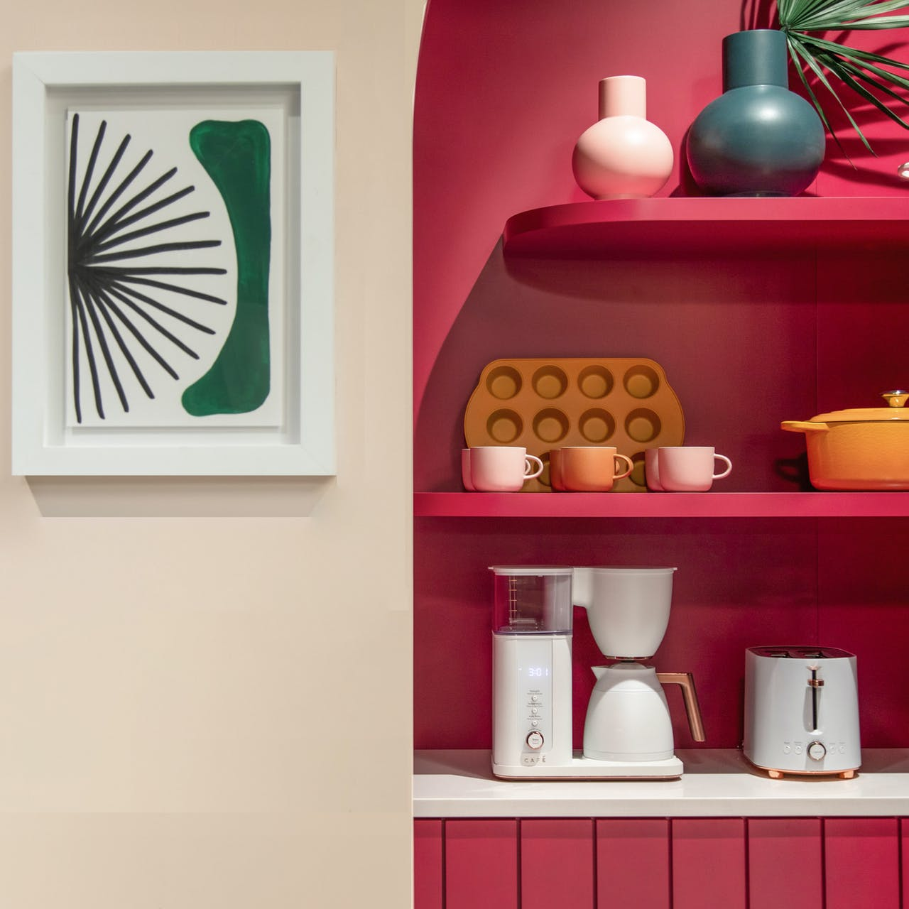 pink wall with cafe coffee maker and toaster in matte white