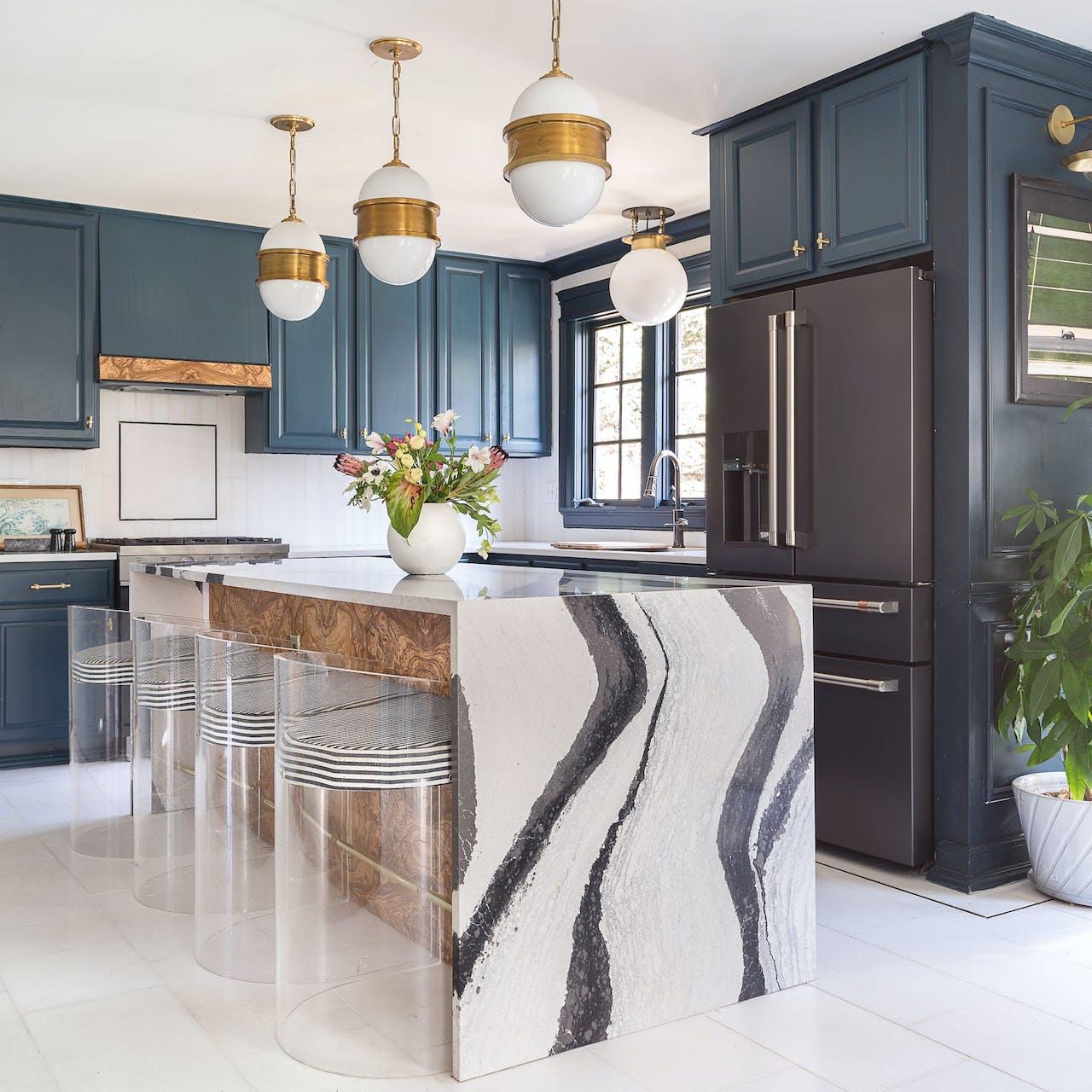 cambria countertop with matte black refrigerator in blue cabinets