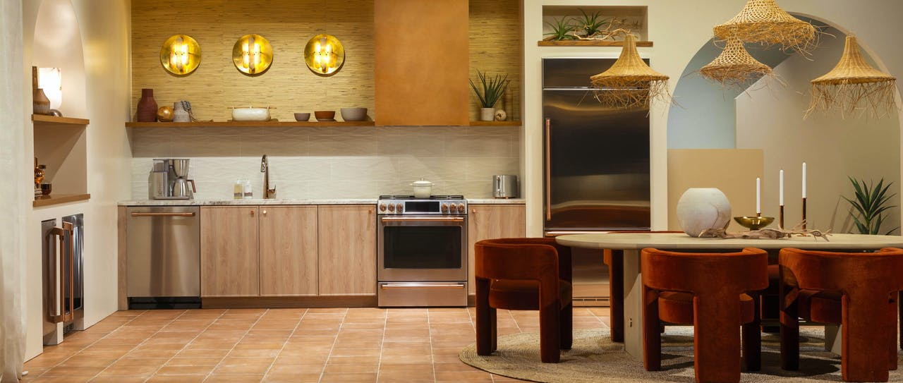 Cafe Desert Daydream kitchen with stainless steel appliances and brushed copper hardware