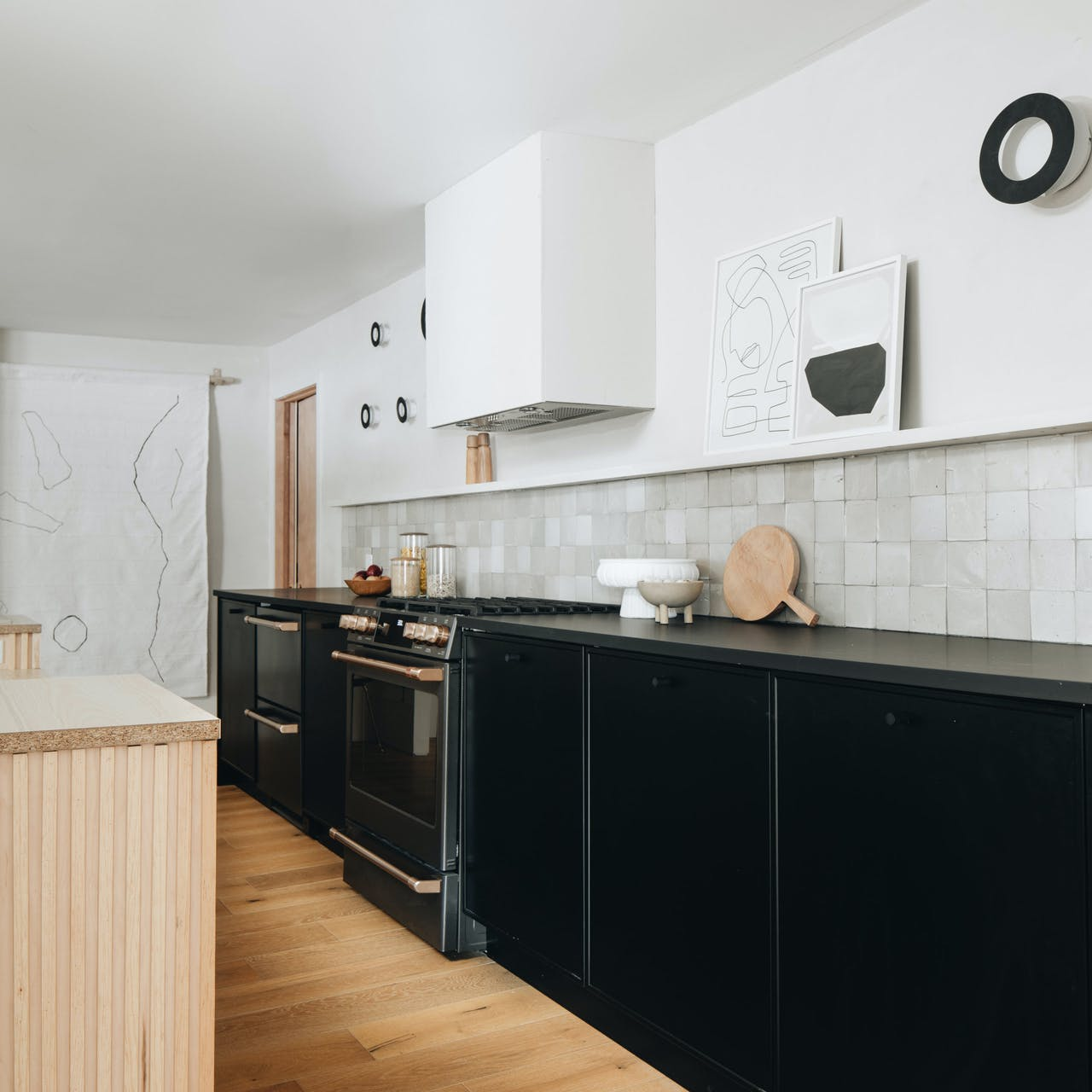 matte black range in semihandmade cabinets