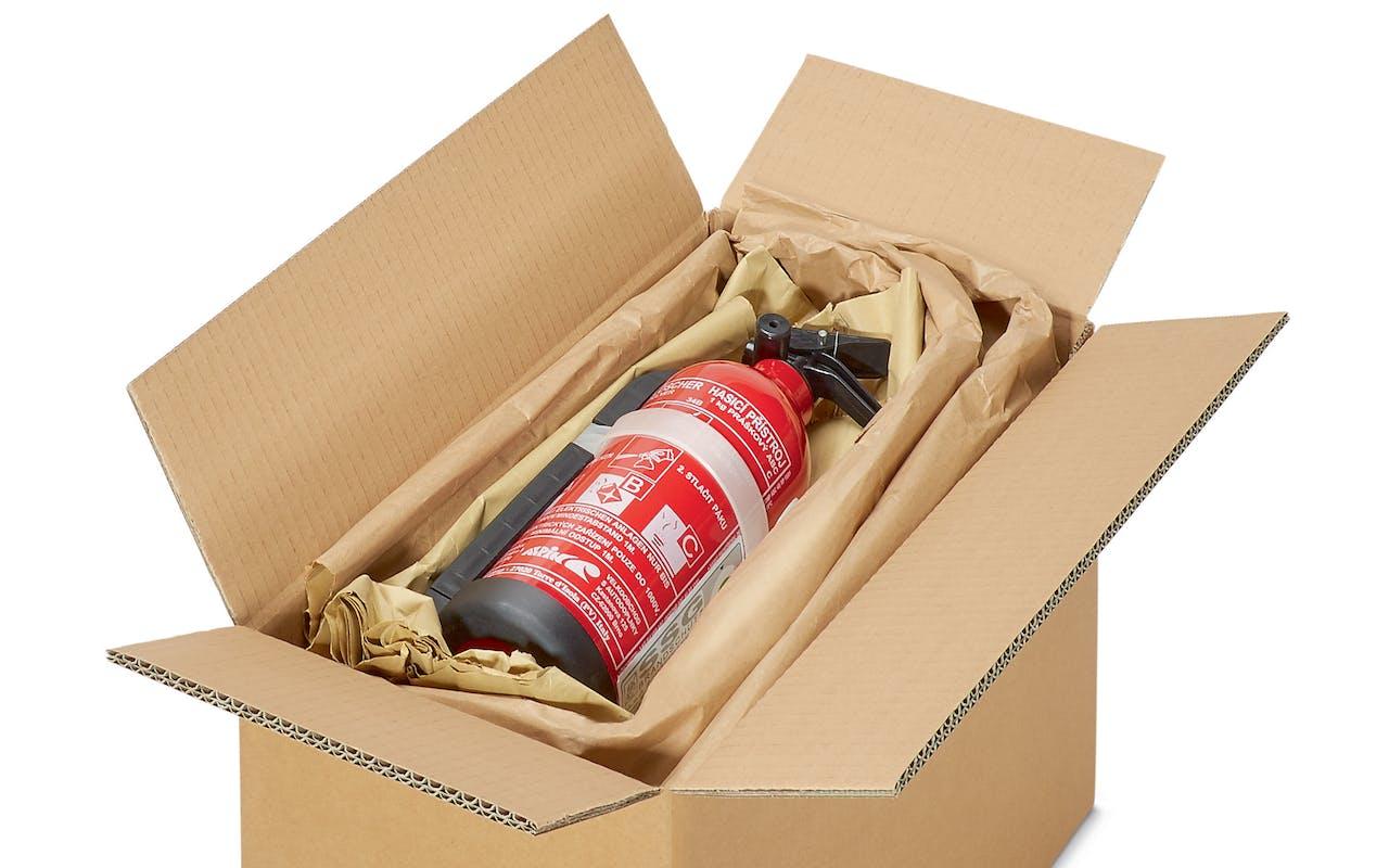 Papierpolster in Karton mit Feuerlöscher