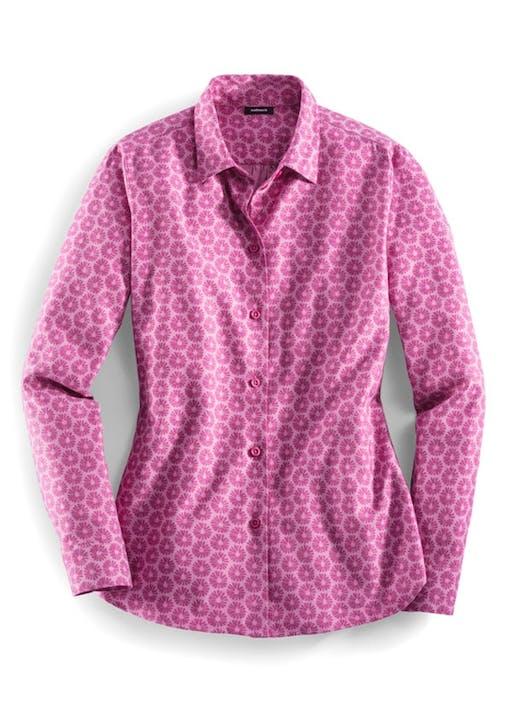 Pinke Bluse mit rundem Dessin.