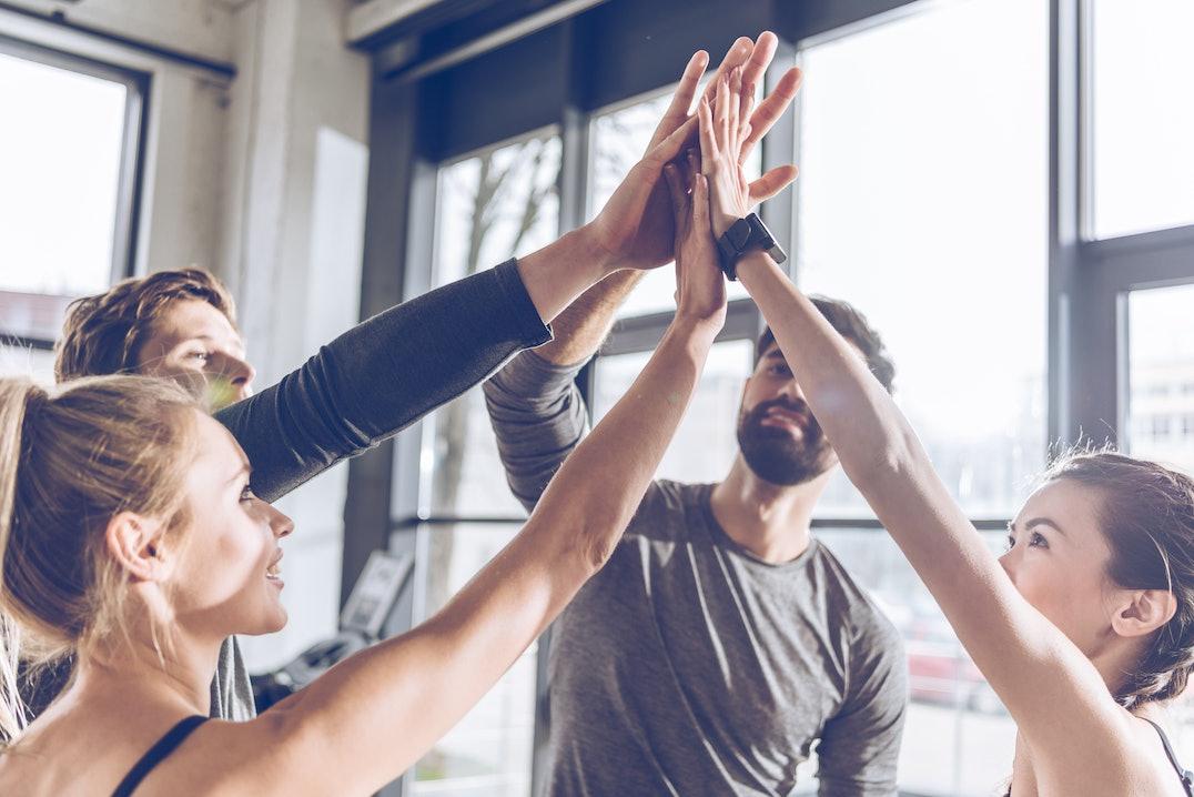 Erfolgreiches Fitfox Training mit glücklichen Sportlern