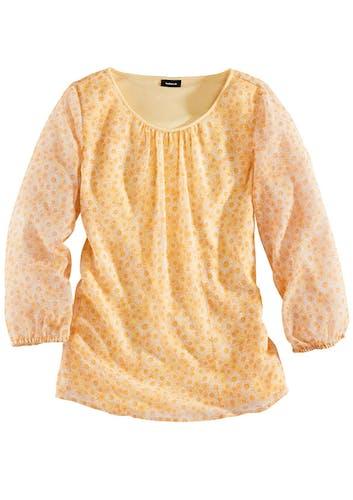 Gelbe Bluse mit gerafften Ärmeln und einem Muster aus Gänseblümchen.