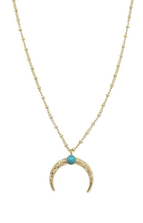 Le collier lune arabesque de la collection oréade est doré à l'Or fin 24 carats et est serti d'une pierre naturelle. Luxueux et accessible, il s'intègrera parfaitement dans vos parures de bijoux.Doré à l'Or fin 24 carats Serti d'une pierre naturelle : 4 mm Longueur de chaîne : 45 cm  Lune : 1,5 cm 5 couleurs Résiste à l'eau. Livré dans un enveloppe cadeau et/ou un pochon.    N'hésitez pas à consulter nos conseils d'entretien afin d'assurer une longue vie à votre bijou Nilaï Paris. Matière principale : Or