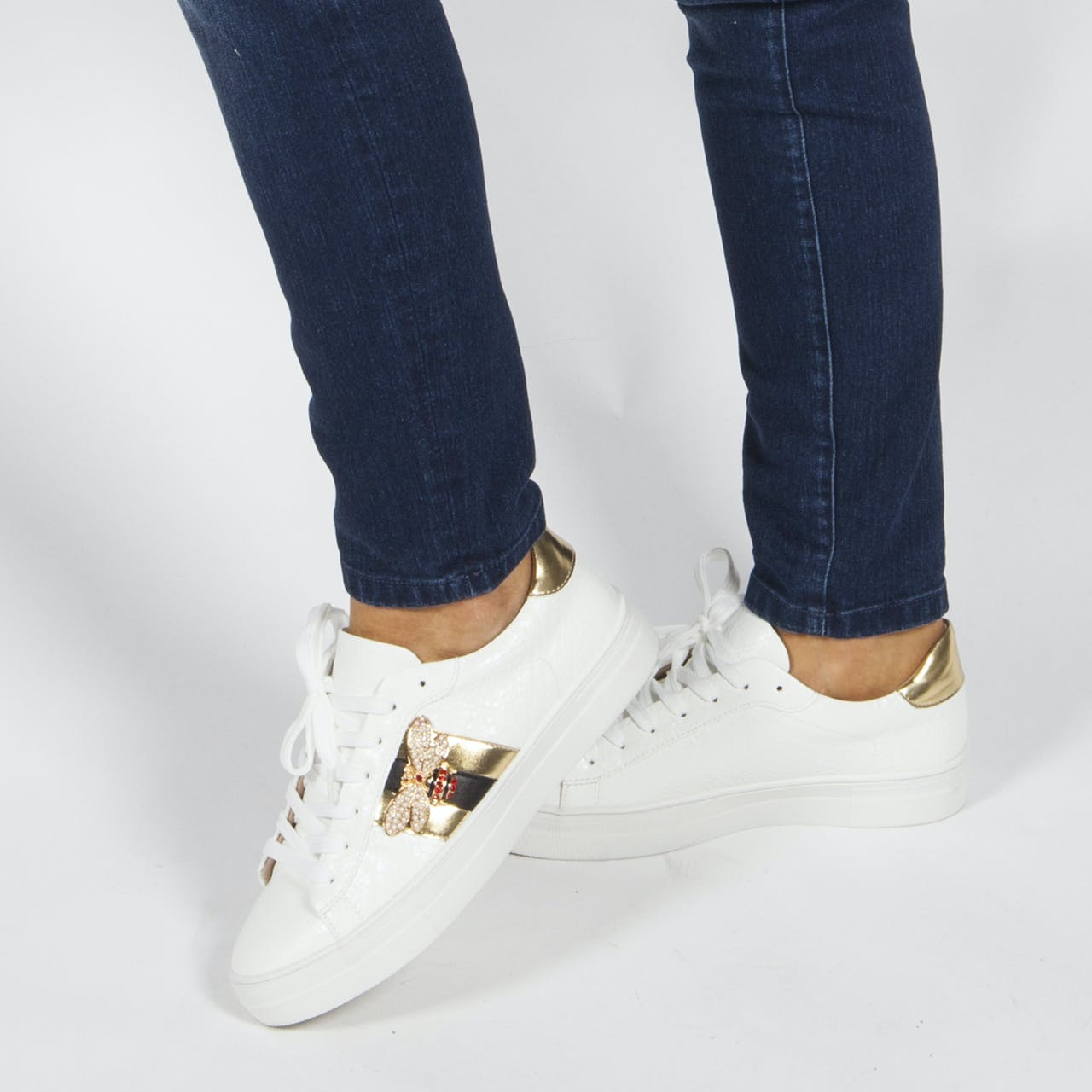 White with gold laced trainers