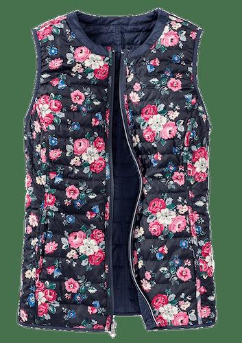 Blaue Wendeweste mit Blumenmuster.
