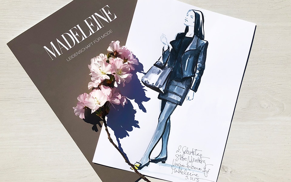 Fashionskizze, Kirschblüten und eine Mappe.