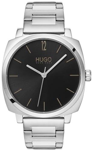 Cette montre HUGO se compose d'un boîtier Carré de 40 mm et d'un bracelet en Acier Gris