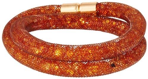 Ce Bracelet CLEOR est en Métal Orange