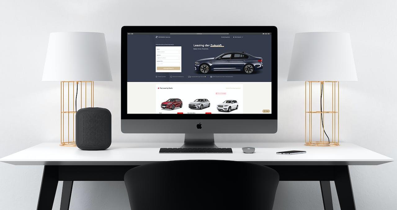 iMac auf Schreibtisch mit Startseite VEHICULUM Gewerbeleasing