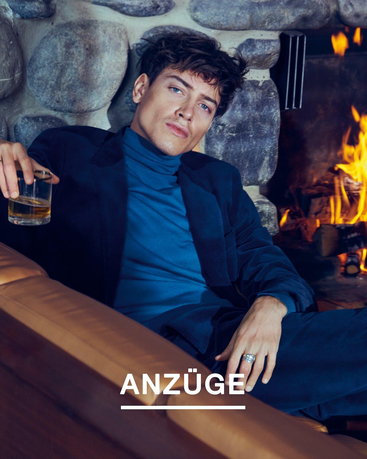 man-sit-suit-blue