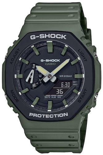Cette Montre pour Homme G-SHOCK Homme se compose d'un Boîtier Rond de 48.5 mm et d'un Bracelet en Résine Verte