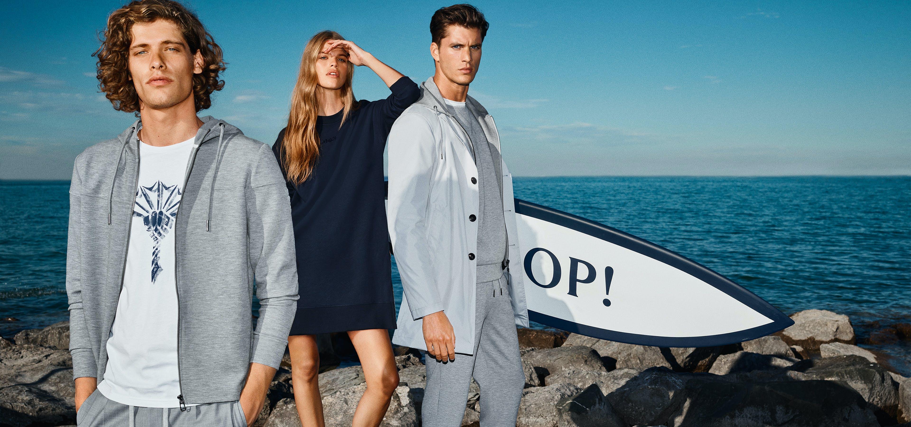 zwei Männer und eine Frau in JOOP! Kleidung am Wasser