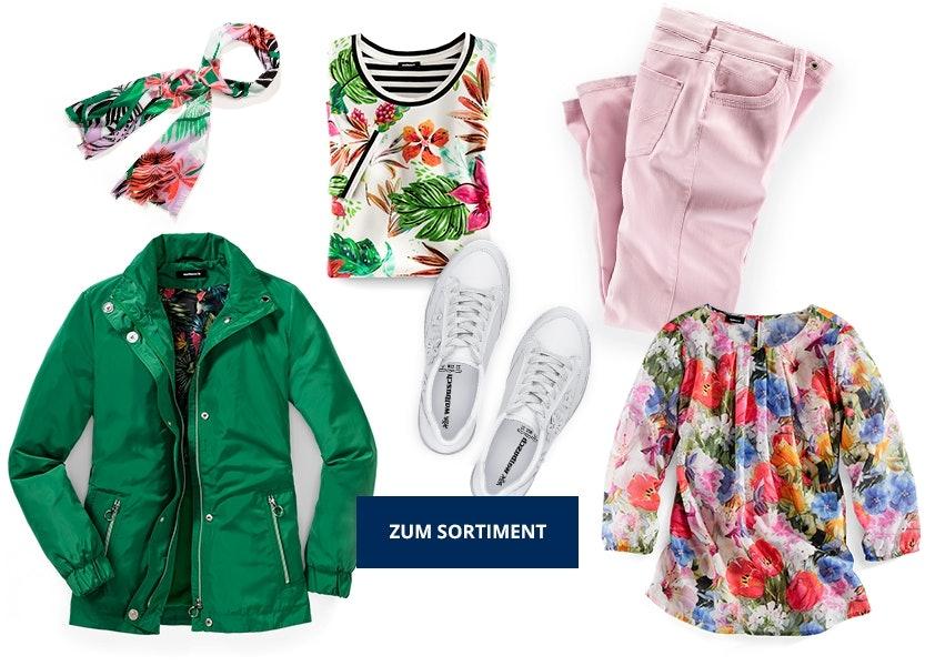 Grüne Jacke, Shirt mit Blumenprint, rosa Hose und Bluse mit buntem Muster.