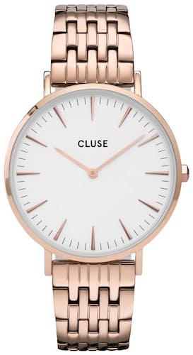 Cette montre CLUSE se compose d'un boîtier Rond de 38 mm et d'un bracelet en Acier Rose
