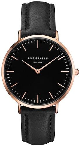 Cette montre ROSEFIELD se compose d'un Boîtier Rond de 38 mm et d'un bracelet en Cuir Noir