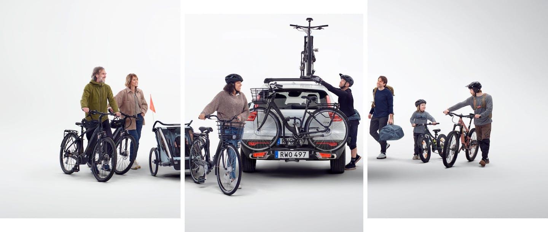 Foto multiple persone vicino ad automobile con bici e rimorchi