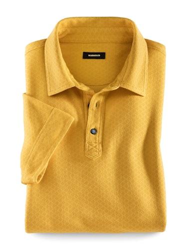 Gelbes Polo mit feinem Dessin und Knopfleiste.