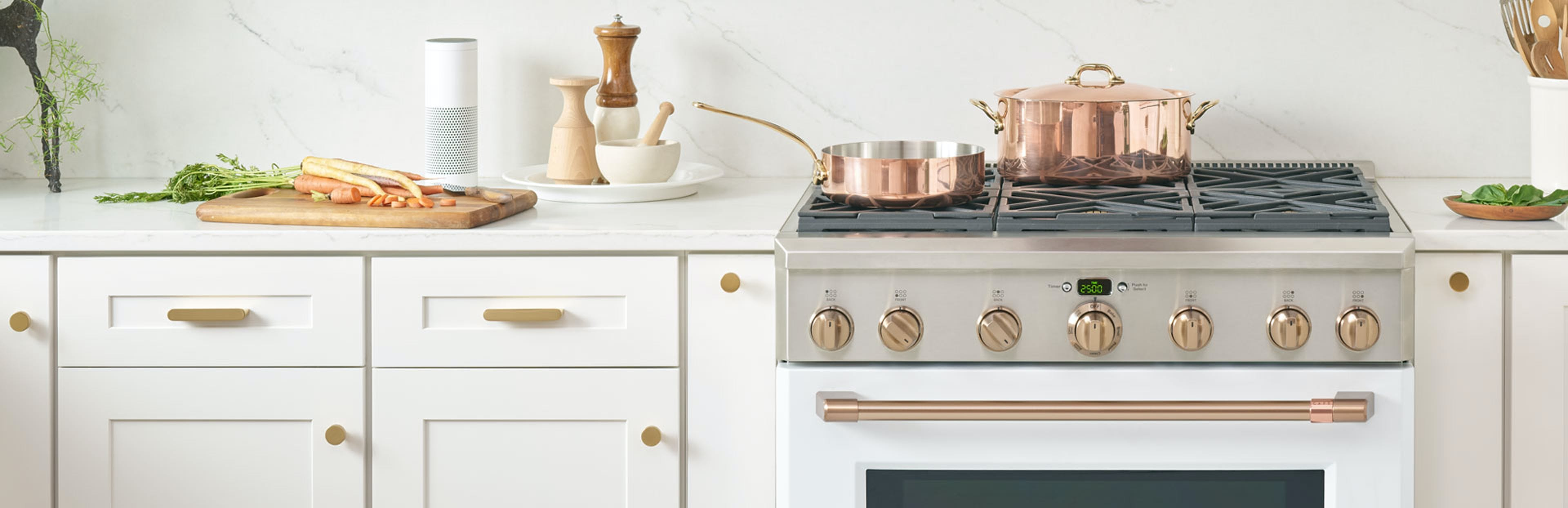 matte white pro range with copper pots
