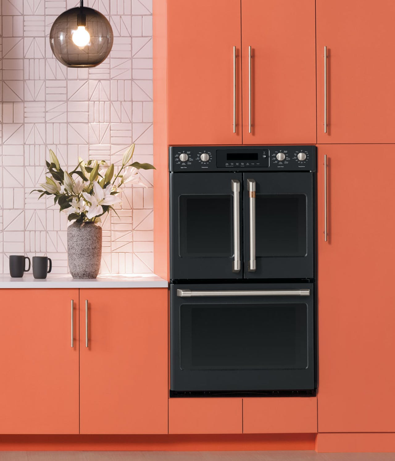 matte black wall oven in coral cabinets