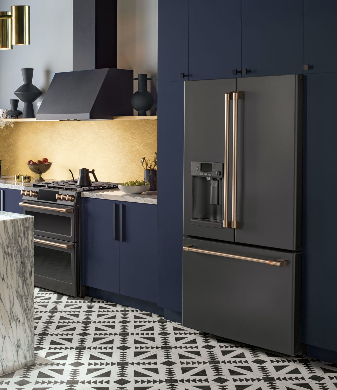 matte black range, hood, and french-door refrigerator in kitchen with navy cabinets