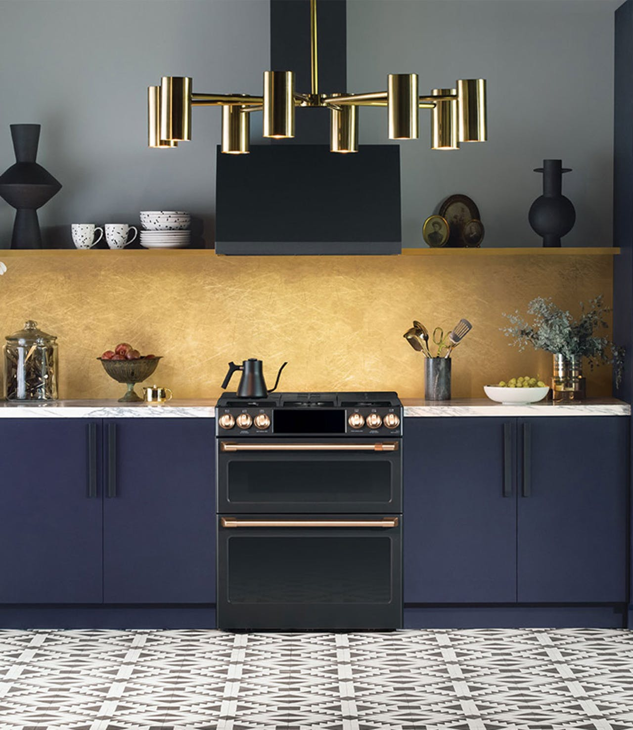 Matte black range in blue cabinets