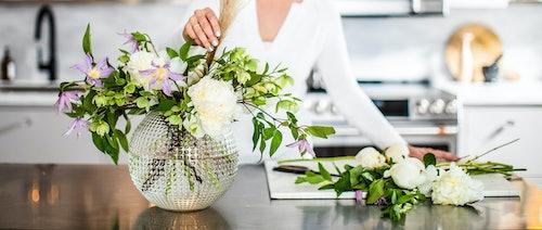 arranging spring flowers in vase
